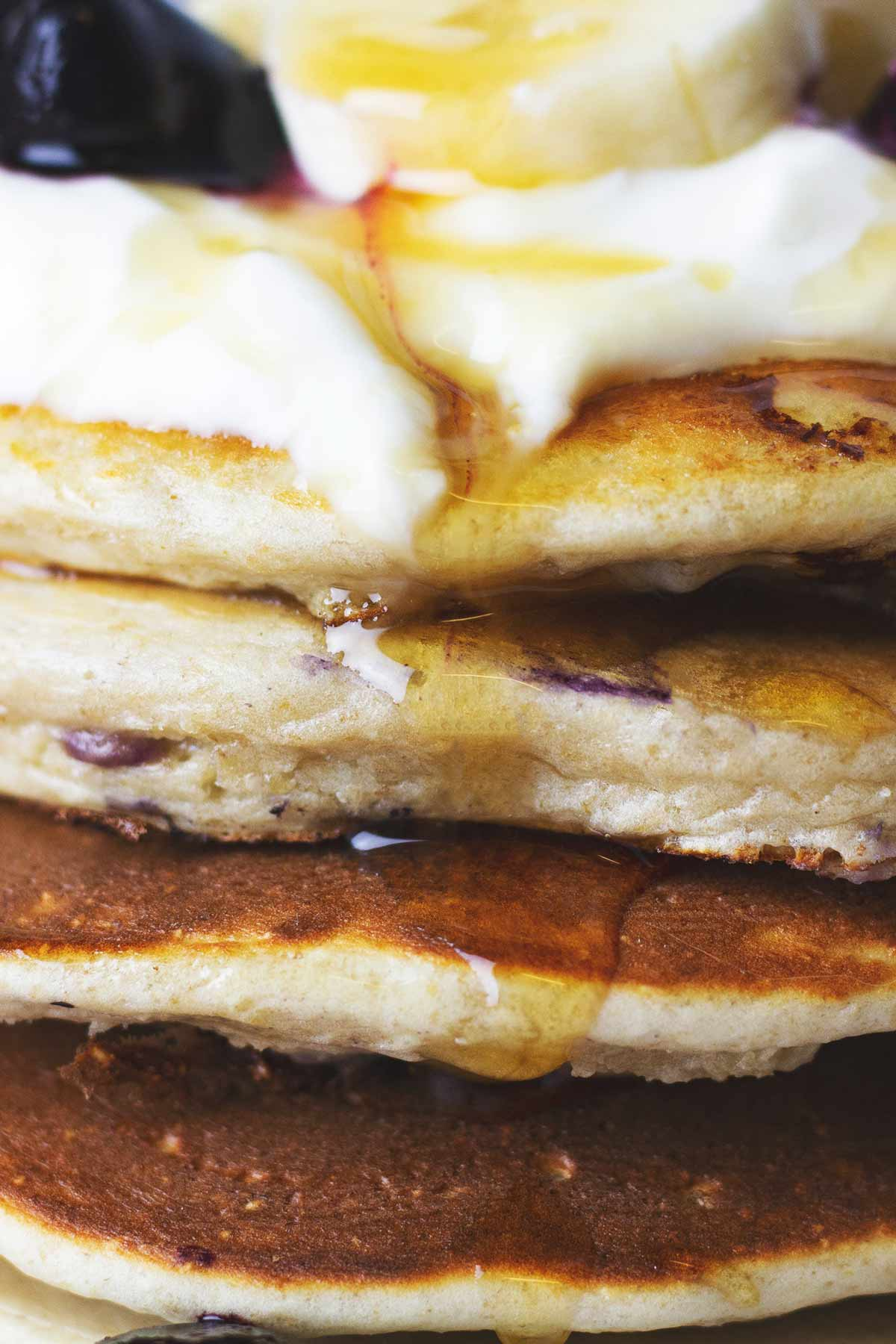 Maple syrup running down pancakes