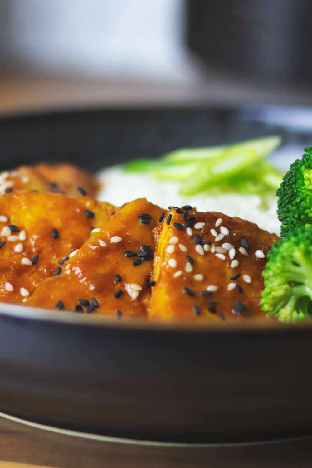 Peanut tamarind tofu in a bowl with rice and broccoli