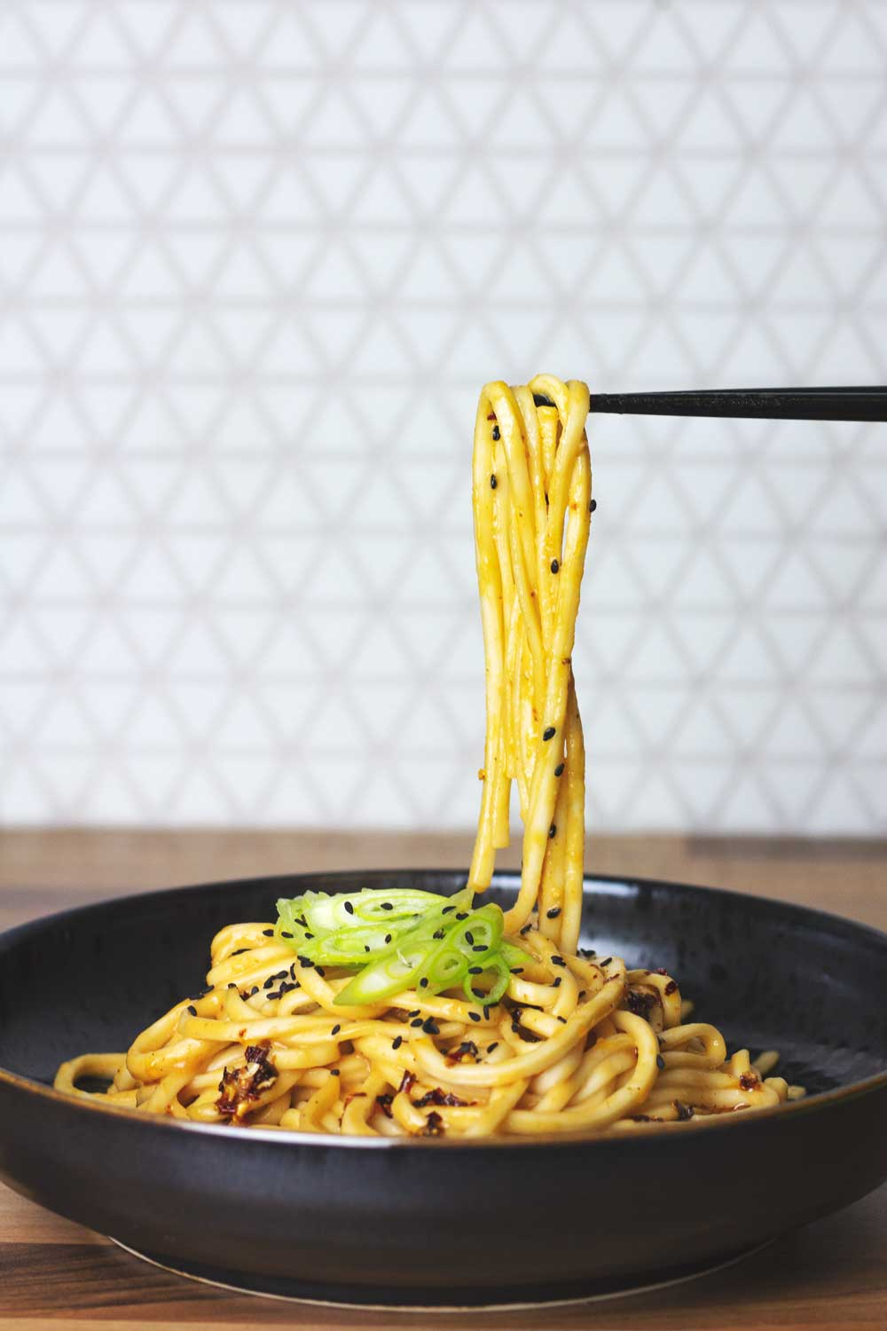 Noodles being picked up by chopsticks