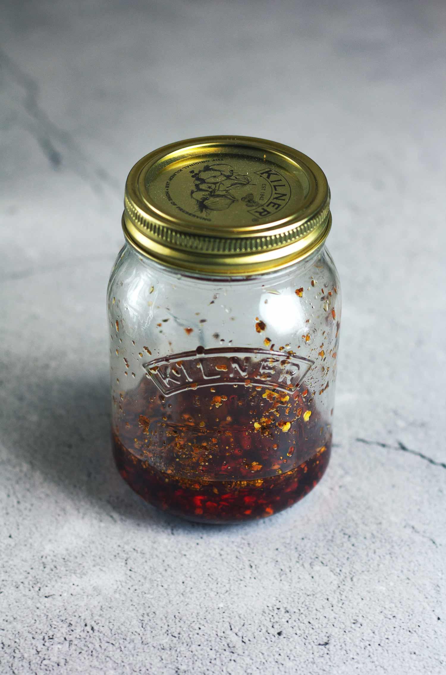 A Kilner jar of chilli oil