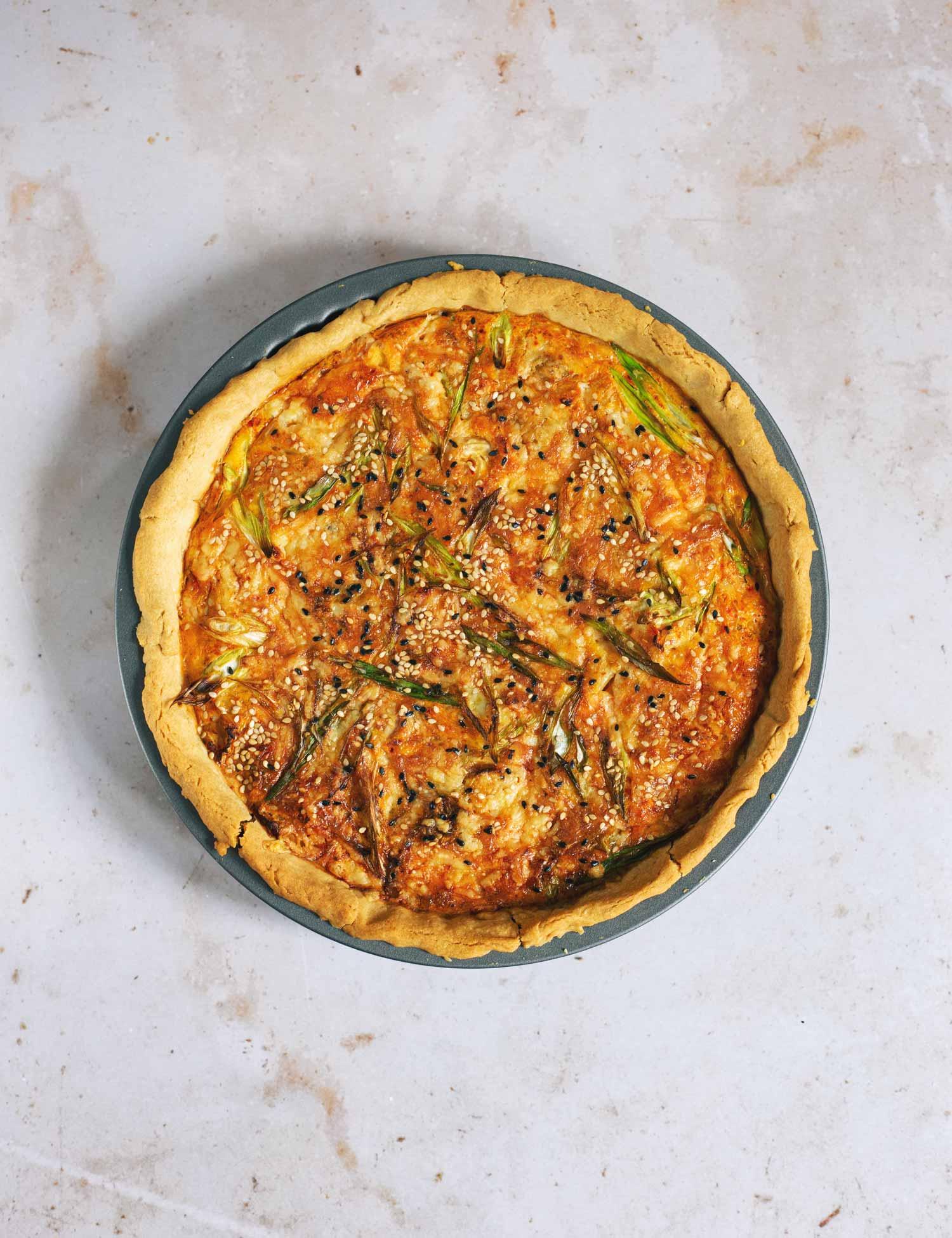 A quiche still in the baking tin