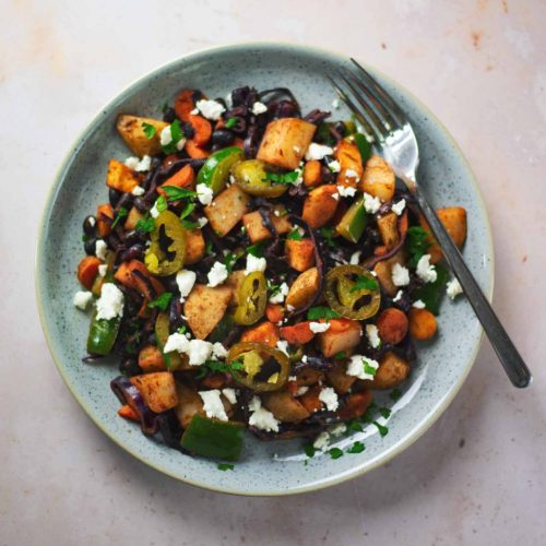 A plate of fried vegetables and beans with feta